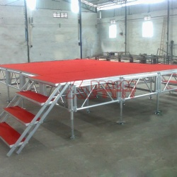 red stage platform outdoor concert stage